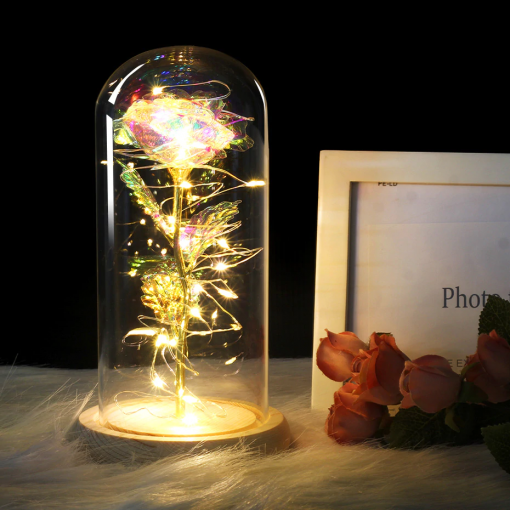 Newplay ros i metall med glaskupa och belysning guld skimrande rose